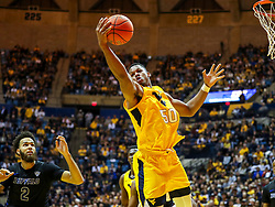 Nov 9, 2018; Morgantown, WV, USA; West Virginia Mountaineers forward Sagaba Konate (50) grabs a rebound during the first half against the Buffalo Bulls at WVU Coliseum. Mandatory Credit: Ben Queen-USA TODAY Sports
