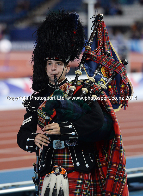 A Scottish Bag Piper  at Valerie Adams' medal ceremony the Women's Shot Put. Track and Field at Hampden Park. Glasgow Commonwealth Games 2014. Wednesday 30 July 2014. Scotland. Photo: Andrew Cornaga/www.Photosport.co.nz