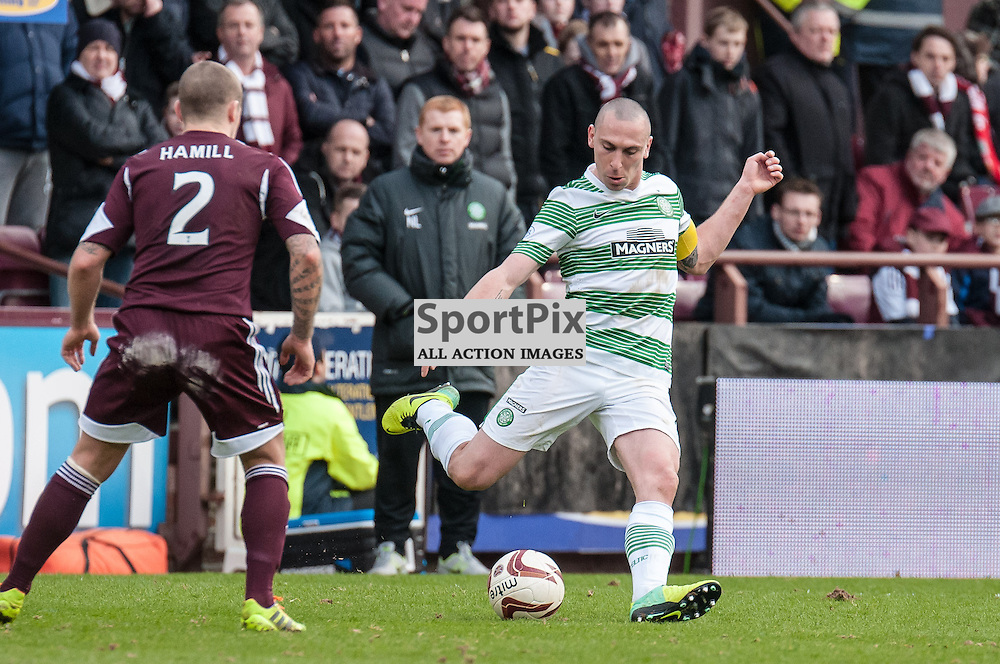 Celtic's Scott Brown plays a long pass during the Hearts v Celtic Scottish Premiership game, 22 February 2014. (c) Paul J Roberts / Sportpix.org.uk