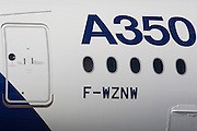 Detail of the Airbus A350 XWB at the Farnborough Air Show, England. The A350 XWB is the only all-new aircraft in the 300-400 seat category. The A350 XWB is a family of long-range, two-engined wide-body jet airliners developed by European aircraft manufacturer Airbus. The A350 is the first Airbus with both fuselage and wing structures made primarily of carbon-fiber-reinforced polymer. It's scheduled to enter commercial service later in 2014.