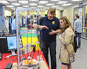 A participant in the Mini Maker Faire demonstrates how 3D printing works.