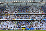 The teams come out into a blue and white flag stadium during the Sky Bet Championship play-off second leg match between Brighton and Hove Albion and Sheffield Wednesday at the American Express Community Stadium, Brighton and Hove, England on 16 May 2016. Photo by Phil Duncan.