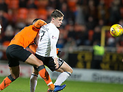 30th November 2018, Tannadice Park, Dundee, Scotland; Scottish Championship football, Dundee United versus Ayr United; Lawrence Shankland of Ayr United shrugs off the challenge of Rachid Bouhenna of Dundee United