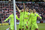 Brighton striker, Tomer Hemed (10) scores a penalty to make it 1-0 and celebrates during the Sky Bet Championship match between Milton Keynes Dons and Brighton and Hove Albion at stadium:mk, Milton Keynes, England on 19 March 2016.