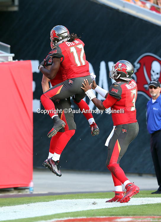 Tampa Bay Buccaneers wide receiver Donteea Dye (17) leaps and celebrates with Tampa Bay Buccaneers quarterback Jameis Winston (3) and Tampa Bay Buccaneers wide receiver Adam Humphries (11) after Humphries catches a fourth quarter touchdown that cuts the New Orleans Saints lead to 24-17 during the 2015 week 14 regular season NFL football game against the New Orleans Saints on Sunday, Dec. 13, 2015 in Tampa, Fla. The Saints won the game 24-17. (©Paul Anthony Spinelli)