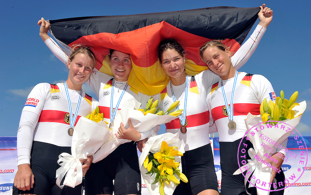 (BOW) BRITTA OPPELT & CARINA BAER & TINA MANKER & (STROKE) JULIA RICHTER (ALL GERMANY) POSE WITH THEIR BRONZE MEDALS IN WOMEN'S QUADRUPLE SCULLS FINAL A DURING REGATTA WORLD ROWING CHAMPIONSHIPS ON KARAPIRO LAKE IN NEW ZEALAND...NEW ZEALAND , KARAPIRO , NOVEMBER 05, 2010..( PHOTO BY ADAM NURKIEWICZ / MEDIASPORT )..PICTURE ALSO AVAIBLE IN RAW OR TIFF FORMAT ON SPECIAL REQUEST.
