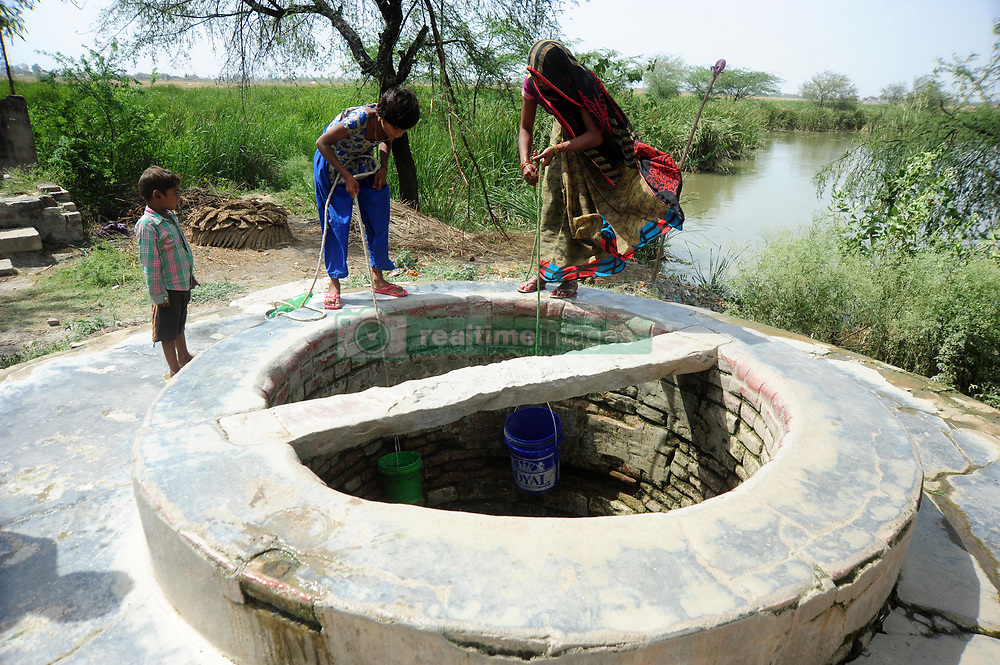 April 26, 2017 - Allahabad, Uttar Pradesh, India - People fill their pots from a partially empty well at Shankargarh area. During Summer approx all well and handpump are parshed. photo by prabhat kumar verma (Credit Image: © Prabhat Kumar Verma via ZUMA Wire)