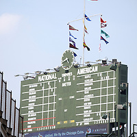 Wrigley Field scoreboard sign. Wrigley Field is home of the Chicago Cubs National League baseball team in Chicago, Illinois USA. The famous manual scoreboard was constructed in 1937 and is changed by hand. Wrigley Field was built in 1914 and is also referred to as The Friendly Confines. Available as high resolution prints and stock photos.