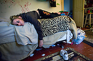 Tabitha Rouzzo, 17, lays on her bed with not much to do after being grounded by her mother in New Castle, PA on April 21, 2012. The energetic life she leads is at school with her friends and staying busy.  She participates in school plays, track and field, works part time and attends youth ministry and church.   Being grounded by her mother, having her cell phone taken away for a month means boredom and proves to be a deflating but effective punishment.   Rouzzo is maining good grades in hopes of a scholarship to boost her out of New Castle which is a shrinking, post-industrial town. (photo by Linda Davidson/The Washington Post)
