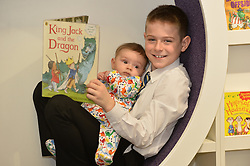 10 year old Jack Shepherd from Penicuik reads a story to 4 month old Jack Capes-Carr from Dundee, to celebrate the fact the name Jack has proved to be the most popular boys name in 2017 for the tenth year running.<br /> <br /> (c) Dave Johnston / Eem
