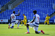 Reading forward Lucas Joao (18) takes the knee before the whistle during the EFL Sky Bet Championship match between Reading and Barnsley at the Madejski Stadium, Reading, England on 19 September 2020.