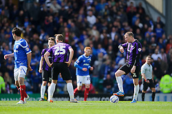 Bristol Rovers players look dejected after Portsmouth score their third goal - Photo mandatory by-line: Rogan Thomson/JMP - 07966 386802 - 19/04/2014 - SPORT - FOOTBALL - Fratton Park, Portsmouth - Portsmouth FC v Bristol Rovers - Sky Bet Football League 2.