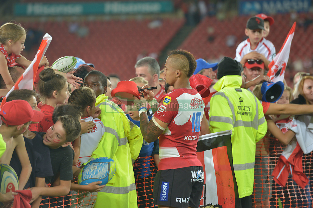 070418 Emirates Airlines Park, Ellis Park, Johannesburg, South Africa. Super Rugby. Lions vs Stormers. Elton Jantjies signs a fans hat after the game.<br />