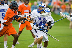 Duke defenseman Dan Theodoridis (46) avoids Virginia midfielder Rhamel Bratton (3).  The #2 ranked Duke Blue Devils defeated the #3 ranked Virginia Cavaliers 11-9 in the finals of the Men's 2008 Atlantic Coast Conference tournament at the University of Virginia's Klockner Stadium in Charlottesville, VA on April 27, 2008.