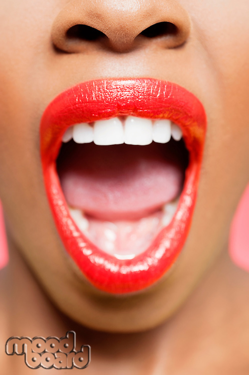 Cropped image of African American woman with red lips and mouth open.