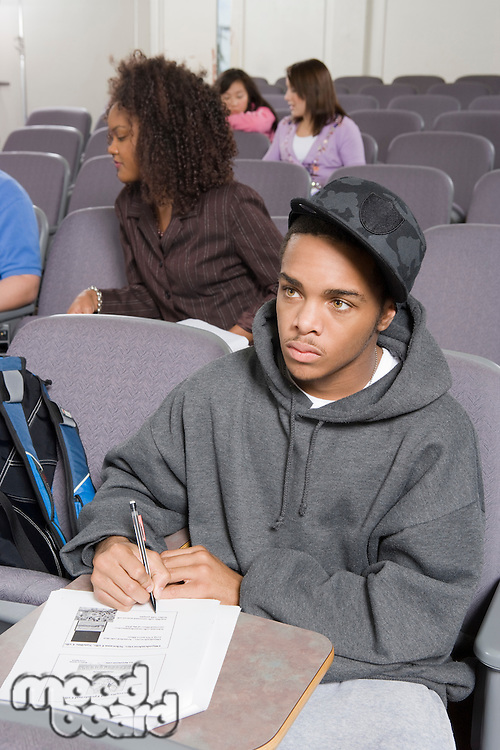University student writing in lecture hall