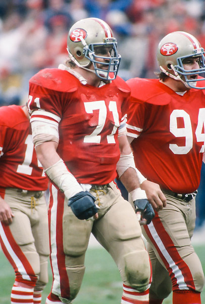 SAN FRANCISCO - JANUARY 6:  Keith Fahnhorst #71 and Louie Kelcher #94 of the San Francisco 49ers approach the line of scrimmage prior to a kick attempt during the NFC Championship game against the Chicago Bears played on January 6, 1985 at Candlestick Park in San Francisco, California. (Photo by David Madison/Getty Images) *** Local Caption *** Keith Fahnhorst