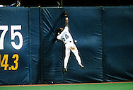 TORONTO, ONTARIO, CANADA - OCTOBER 16:  Rickey Henderson of the Toronto Blue Jays can't catch a fly ball during Game 1 of the 1993 World Series at the Skydome on October 16,1993 in Toronto, Ontario, Canada.  (Photo by Ron Vesely)