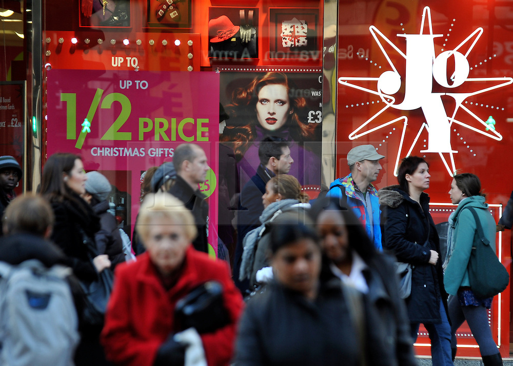 © Licensed to London News Pictures. 09/12/2011, London, UK. Crowds on Oxford Street. Christmas shoppers in London's Oxford Street and Regent Street today 09 December 2011. Some of the shops are already having sales and displaying prices in windows. Photo credit : Stephen Simpson/LNP