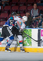 KELOWNA, CANADA - SEPTEMBER 3: Gordie Ballhorn #4 of Kelowna Rockets is checked at the boards by a player of the Victoria Royals on September 3, 2016 at Prospera Place in Kelowna, British Columbia, Canada.  (Photo by Marissa Baecker/Shoot the Breeze)  *** Local Caption *** Gordie Ballhorn;
