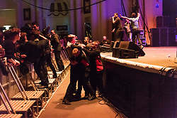 "© Licensed to London News Pictures. 01/05/2015. London, UK.   Audience members struggle with security staff as dozens invade the stage at Brixton Academy, after they were encouraged to do so by the performing musical artist Jay Electronica seen onstage, supporting headliner Flying Lotus.  Multiple audience members were ejected from the venue by security.  Jay Electronica is Timothy Elpadaro Thedford , an American hip hop recording artist and record producer whose album ""Act I: Eternal Sunshine (The Pledge)"" was described as 'a timeless classic' by Vice Magazine. Photo credit : Richard Isaac/LNP"