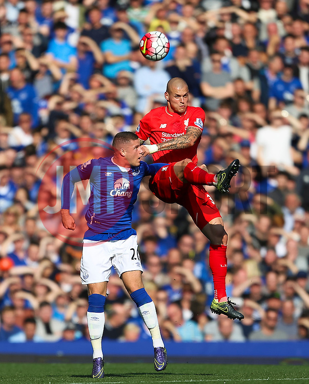Martin Skrtel of Liverpool wins a header above Everton's Ross Barkley   - Mandatory byline: Matt McNulty/JMP - 07966 386802 - 04/10/2015 - FOOTBALL - Goodison Park - Liverpool, England - Everton  v Liverpool - Barclays Premier League