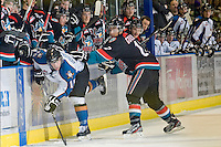 KELOWNA, CANADA, NOVEMBER 25: Tyrell Goulbourne #12 of the Kelowna Rockets checks Adam Rossignol #15 of the Kootenay Ice as the Kootenay Ice visit the Kelowna Rockets  on November 25, 2011 at Prospera Place in Kelowna, British Columbia, Canada (Photo by Marissa Baecker/Shoot the Breeze) *** Local Caption *** Tyrell Goulbourne; Adam Rossignol;