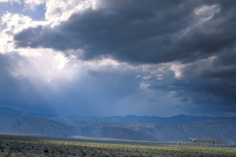 Sunbeams and spring storm clouds over the Cottonwood Mountains, Death Valley National Park, California