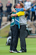 Miguel Angel Jimenez hugs his caddy after winning the Rolex Senior Golf Open at St Andrews, West Sands, Scotland on 29 July 2018. Picture by Malcolm Mackenzie.