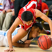 120513   Brian LEddy<br /> Monument Valley Mustang Brayton Begay (12) falls over Window Rock Scout Cody Long (21)during Thursday's Coca Cola Classic in Chinle. The Mustangs won 60-56.