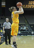 December 30, 2011: Iowa Hawkeyes guard Samantha Logic (22) puts up a three point shot during the NCAA women's basketball game between the Northwestern Wildcats and the Iowa Hawkeyes at Carver-Hawkeye Arena in Iowa City, Iowa on Wednesday, December 30, 2011.