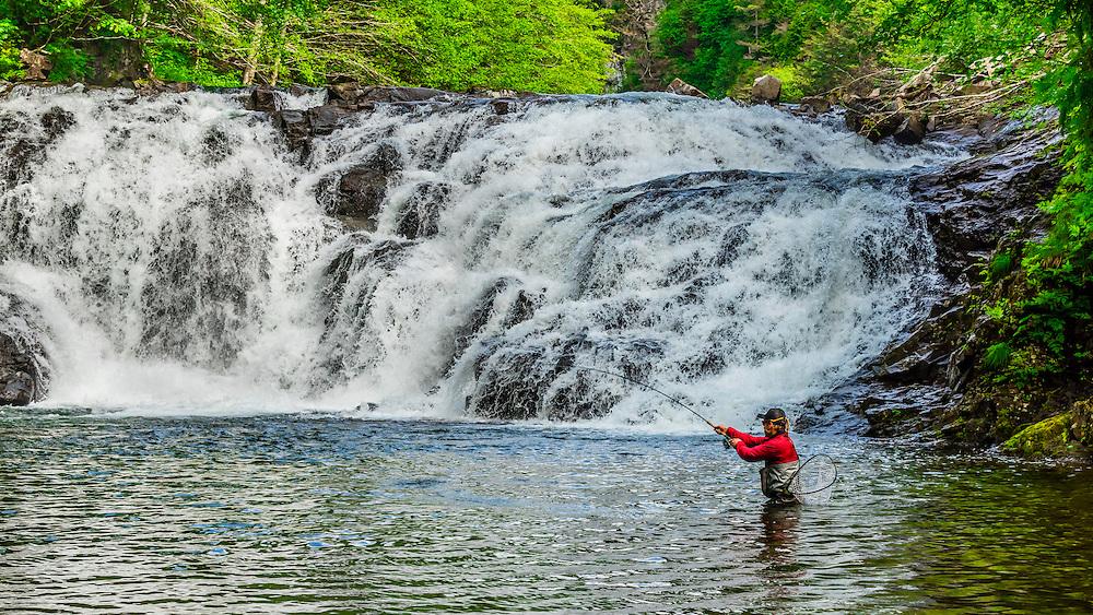 Flyfishing guide from Sitka Alaska Outfitters fishing the Lower Falls of Sawmill Creek, near Sitka, Alaska USA.