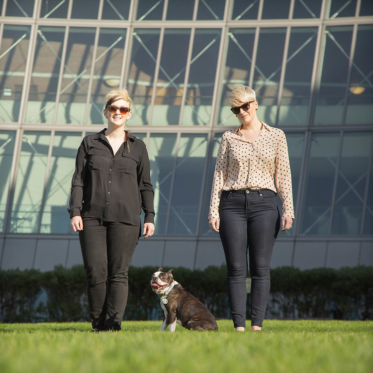 In front of Boston Federal Courthouse. Standing with Boston terrier wearing sunglasses.