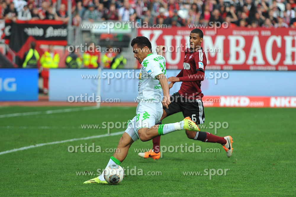 05.04.2014, easyCredit Stadion, Nuernberg, GER, 1. FBL, 1. FC Nuernberg vs Borussia Moenchengladbach, 29. Runde, im Bild Juan Arango (Borussia Moenchengladbach / vorne) setzt zum Torschuss an. Im Hintergrund: Martin Angha (1.FC Nuernberg) // during the German Bundesliga 29th round match between 1. FC Nuernberg and Borussia Moenchengladbach at the easyCredit Stadion in Nuernberg, Germany on 2014/04/05. EXPA Pictures &copy; 2014, PhotoCredit: EXPA/ Eibner-Pressefoto/ Merz<br /> <br /> *****ATTENTION - OUT of GER*****