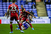 Reading midfielder John Swift (10) slides in to tackle Fulham midfielder Bobby Reid (14) for which he receives a yellow card during the EFL Sky Bet Championship match between Reading and Fulham at the Madejski Stadium, Reading, England on 1 October 2019.