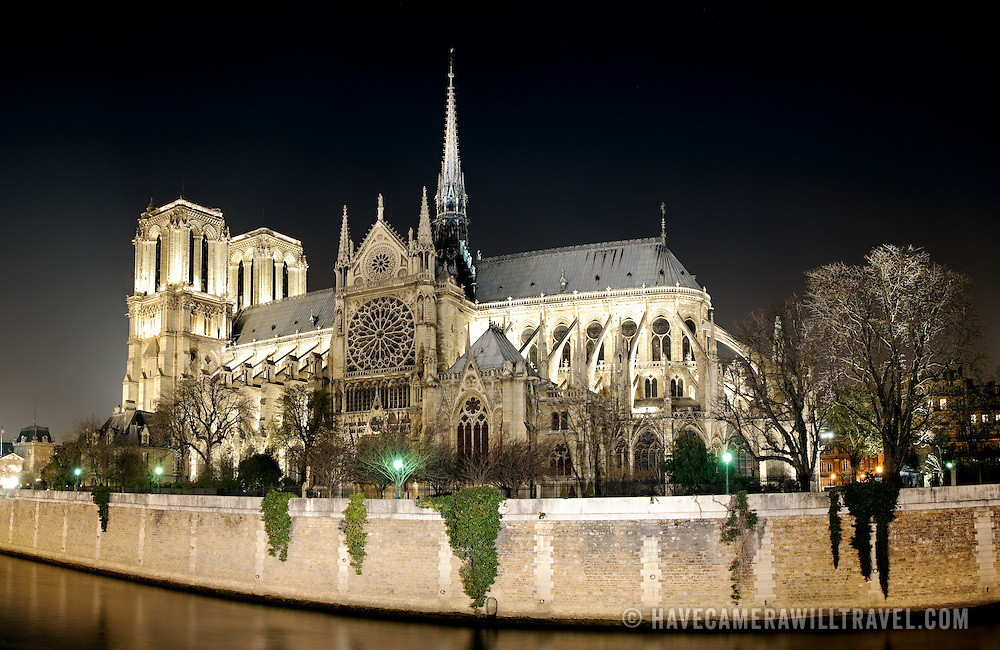 View of the back of Notre Dame to Paris at night, looking down the Seine