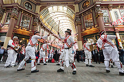 © Licensed to London News Pictures. 21/04/2017. LONDON, UK. Morris dancers perform in Leadenhall Market in the City of London today, ahead of the official St George's Day this Sunday. Photo credit: Vickie Flores/LNP