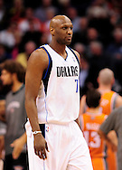 Mar. 08, 2012; Phoenix, AZ, USA;  Dallas Mavericks forward Lamar Odom (7) reacts while on the court during a game against the Phoenix Suns at the US Airways Center.  The Suns defeated the Mavericks 96-94. Mandatory Credit: Jennifer Stewart-US PRESSWIRE..