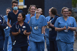 © Licensed to London News Pictures. 30/04/2020. London, UK. Emergency medicine nurses and doctors emerge briefly from A&E for the 8pm Thursday Clap for Carers at Charing Cross Hospital in Hammersmith.  Photo credit: Guilhem Baker/LNP