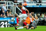 Federico Fernandez (#18) of Newcastle United slides in to wn the ball denying Pierre-Emerick Aubameyang (#14) of Arsenal a clear run on goal during the Premier League match between Newcastle United and Arsenal at St. James's Park, Newcastle, England on 15 September 2018.