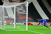 Middlesbrough Goalkeeper Dimitrios Konstantopoulos scrambles to prevent a goal during the Sky Bet Championship match between Milton Keynes Dons and Middlesbrough at stadium:mk, Milton Keynes, England on 9 February 2016. Photo by Dennis Goodwin.