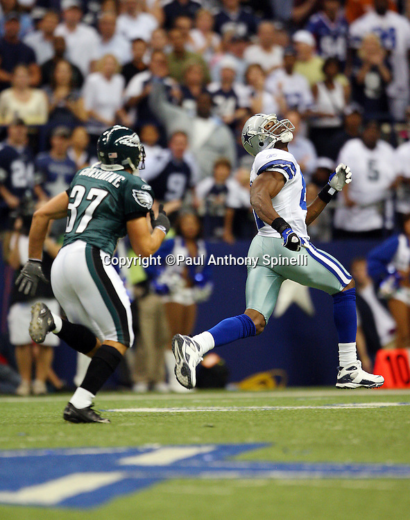 IRVING, TX - SEPTEMBER 15:  Wide receiver Terrell Owens #81 of the Dallas Cowboys runs downfield to catch a 72 yard touchdown pass for a 7-3 Cowboys first quarter lead while covered by safety Sean Considine #37 of the Philadelphia Eagles at Texas Stadium on September 15, 2008 in Irving, Texas. The Cowboys defeated the Eagles 41-37. ©Paul Anthony Spinelli *** Local Caption *** Terrell Owens;Sean Considine