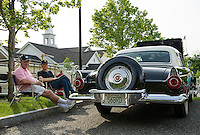 Bob Gage sits with Bill Pond by his 1956 Thunderbird during Cruise Night at the Gilford Community Center on Thursday evening.  (Karen Bobotas/for the Laconia Daily Sun)