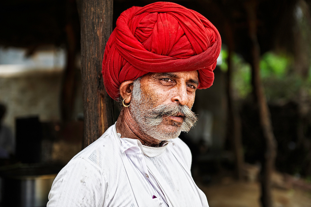 A man from Rabari tribe herding the sheep. The Rabari are the pastoral group of Western India. Most live in Rajasthan and Gujarat, but some also live in Punjab, Haryana, and Madhya Pradesh and perhaps in other states.