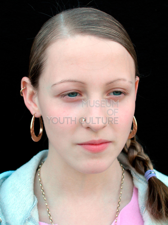 Girl with nose stud and hoop earings