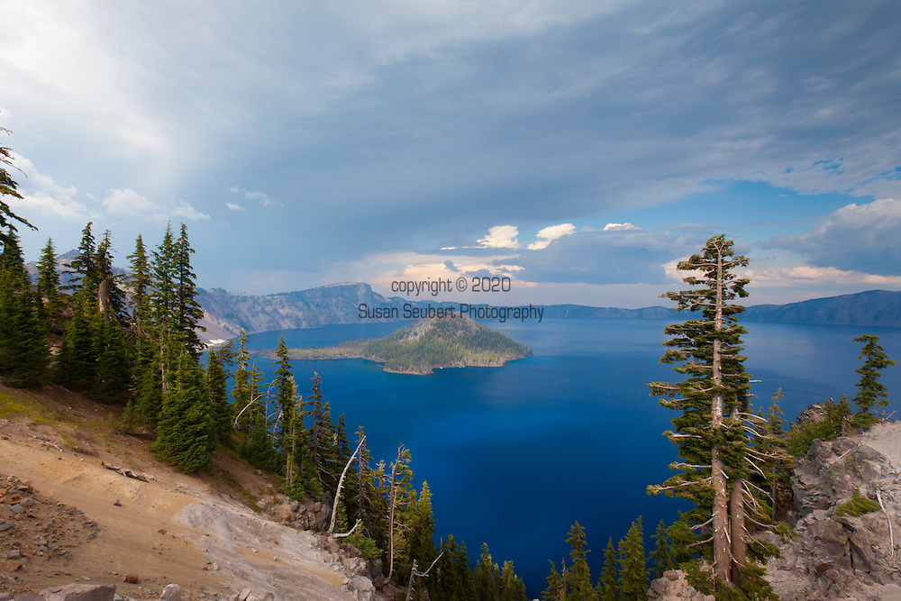 Crater Lake National Park, the only National Park in the state of Oregon, attracts some 482,000 people annualy. The lake itself is 592 meters (1,943ft) deep and is the deepest lake in the United States.  The park was founded in 1902 and seeks to preserve the natural and cultural resources.  Crater Lake lies in a caldera, or volcanic basin, created when Mt. Mazama collapsed around 7,700 years ago.  The clarity and blueness of the water are unique to this geologic area.  The lake is filled almost entirely by melted snow.  The lake is only accessibly by one trail, the Cleetwood Cove Trail, which leads down to the water for access to the tourist boats.  The view of the lake from Crater Rim Drive.