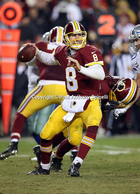 Washington Redskins quarterback Kirk Cousins (8) throws a pass under fourth quarter pressure from Dallas Cowboys outside linebacker Sean Lee (50) during the 2015 week 13 regular season NFL football game against the Dallas Cowboys on Monday, Dec. 7, 2015 in Landover, Md. The Cowboys won the game 19-16. (©Paul Anthony Spinelli)