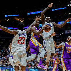 Jan 28, 2018; New Orleans, LA, USA; New Orleans Pelicans guard Jrue Holiday (11) goes to the basket between LA Clippers forward Montrezl Harrell (5) and guard Lou Williams (23) during the fourth quarter at the Smoothie King Center. The Clippers defeated the Pelicans 112-103. Mandatory Credit: Derick E. Hingle-USA TODAY Sports