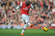 Arsenal's Bacary Sagna striking from the 25-yard line during Barclays Premier League , Arsenal v Sunderland at the Emirates Stadium in London, England on Saturday 22nd Feb 2014.<br /> pic by John Fletcher, Andrew Orchard sports photography.