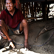 Bali, Indonesia. Mental diseases in paradise. The Balinese community doesn't accept the existance of this illness. Famillies and people are not well informed and ready to face the disease. Nengah, 56 years old, schizophrenic for 11 years, in chain for 5 years..His family doesn't release him otherwise he becomes aggressive.